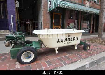 Image of Arnold's Bar with a bathtub out front that was used in making bathtub gin. - Stock Photo