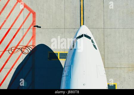 Aerial view of the airport. Airplane taxiing to terminal. - Stock Photo