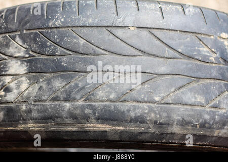 Old worn car tires on a gray background - Stock Photo