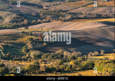 An idyllic landscape large view over Montepulciano countryside, as seen from the town's top, bathed in the autumn - Stock Photo