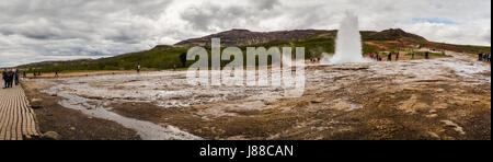 Panorama of Strokkur (the Churn), Geysir (geyser) , Golden Circle in Iceland - Stock Photo