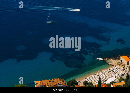 Sailboat near the old town of Dubrovnik in Croatia. - Stock Photo