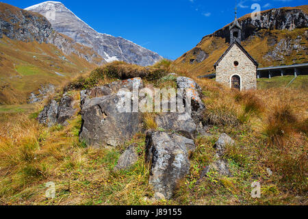 Small chapel on the top serpentines of The Grossglockner Hochalpenstrasse, a famous mountain road in Austria - Stock Photo