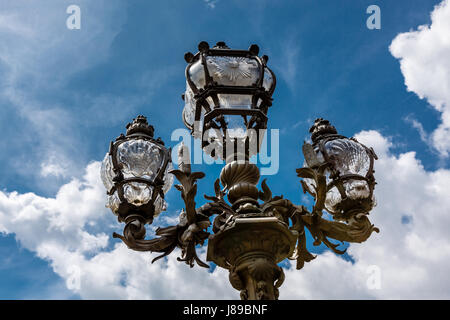 Street Lantern on the Alexandre III Bridge against Cloudy Sky, Paris, France. - Stock Photo
