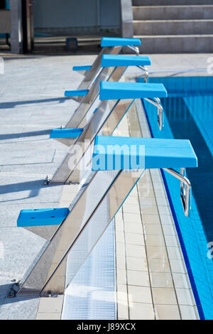Olympic Swimming Starting Blocks starting blocks in a olympic swimming pool stock photo, royalty