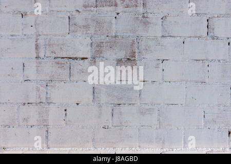 Detail of a brick wall painted in white - Stock Photo