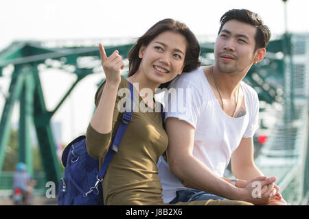 couples of younger asian man and woman relaxing with happy face on vacation tirp - Stock Photo
