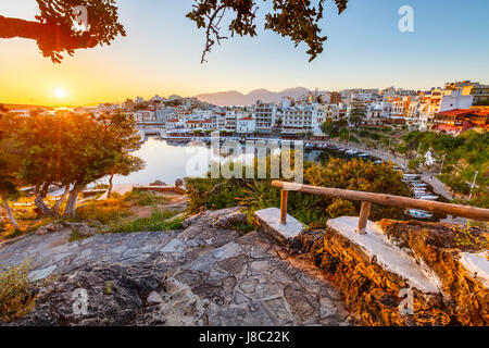 Morning view of Agios Nikolaos and its harbor, Crete, Greece. - Stock Photo