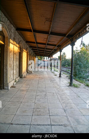 Disused and neglected Train station - Stock Photo