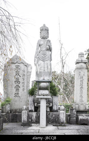 Kyoto, Japan - November 2016: Statue of Kannon (Guanyin) or Goddess of Mercy, an East Asian bodhisattva, situated at Enkoji temple in Kyoto, Japan