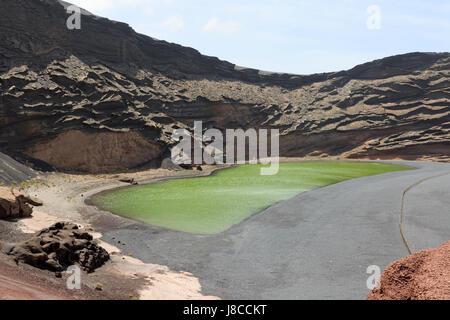 The Green lagoon ( Lago Verde ), in an extinct volcano crater, El Golfo, Lanzarote, Canary Islands Europe - Stock Photo