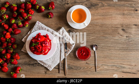 Top view strawberry diet on a breakfast with tea. - Stock Photo