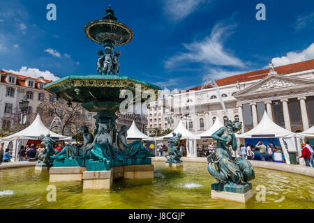 Baroque Fountain on Rossio Square the Liveliest Placa in Lisbon, Portugal - Stock Photo
