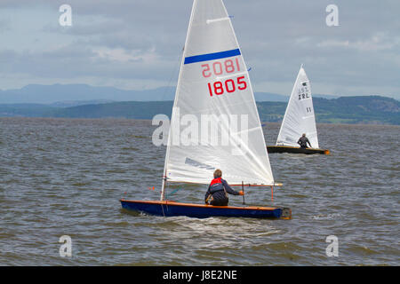 Morecambe, Lancashire, UK. UK Weather. 28th May, 2017. Sun breaks through on Morecambe Bay Sailing Club sailors - Stock Photo