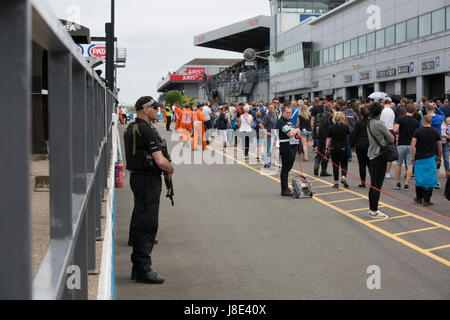 Donington Park, UK. 28th May, 2017. Armed police patrolling the pit lane after terror attacks in Manchester UK Credit: - Stock Photo