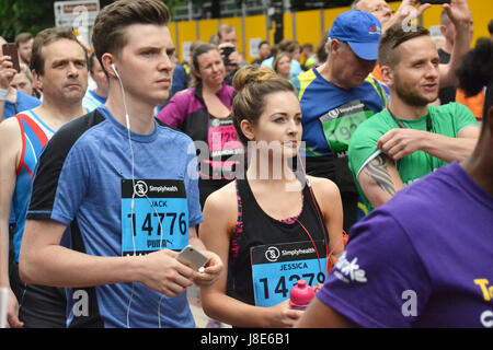 Manchester, UK. 28th May, 2017. Runners prepare to take part in the Greater Manchester Run on Sunday 28th May 2017. - Stock Photo