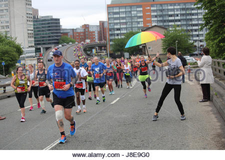 Manchester, UK. 28th May, 2017. Runners cross a bridge in central Manchester today during the road race held there. - Stock Photo