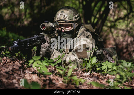 Photo of soldier in ambushed at woods by day - Stock Photo