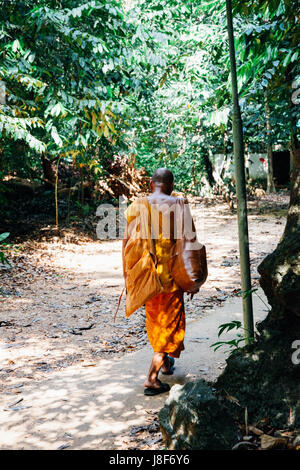 KRABI, THAILAND - APRIL 10: Buddhist monk walking through the rainforest on April 10, 2016 in Krabi, Thailand. - Stock Photo