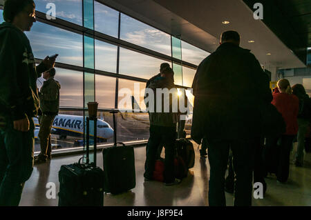 Early morning Dublin airport Ryanair boarding queue - Stock Photo