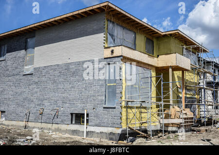 A new stick built home under construction - Stock Photo
