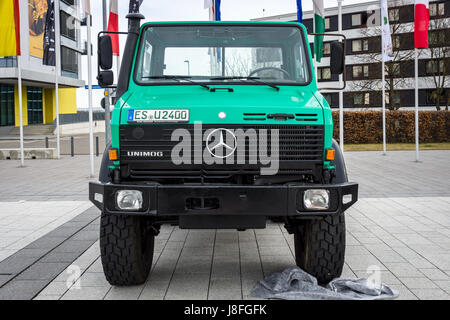 The multi-purpose all-wheel drive truck truck Unimog U2400, 2000. Europe's greatest classic car exhibition 'RETRO - Stock Photo