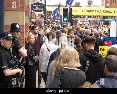 Police and onlookers at the Great Manchester Run 2017 - Stock Photo