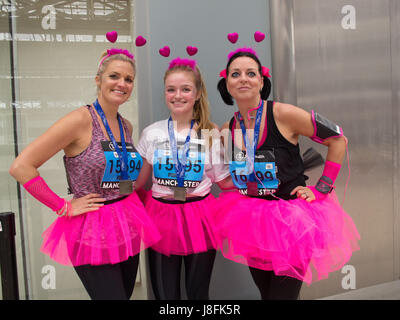 Three ladies on their way home after running in the Great Manchester Run - Stock Photo