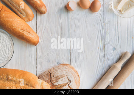 Cooking baking ingredients isolated on table - Stock Photo