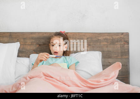 Young teenager girl alone at home childhood - Stock Photo