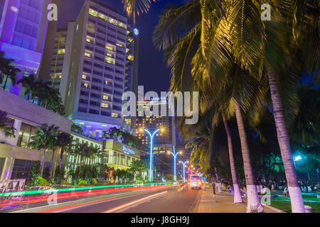 Nha Trang, Vietnam - December 11, 2015: Night view of  the beachfront road with luxury hotels line along it December - Stock Photo