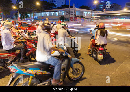 Ho Chi Minh City, Vietnam - November 19, 2015: Motorbike driver are waiting for the green signal at the crossroad - Stock Photo