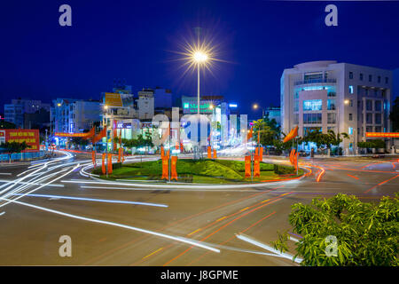 Nha Trang, Vietnam - December 23, 2015: Dusk view of the traffic circle in the center of Nha Trang city on December - Stock Photo