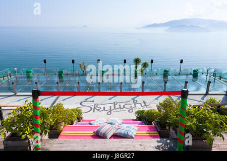 Nha Trang, Vietnam - January 5, 2016: Panoramic daytime view of the sea and hills from the rofftop bar on January - Stock Photo