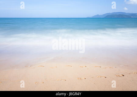 Blurred sea waves motion, Nha Trang, Vietnam. - Stock Photo