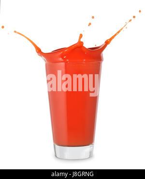 tomato juice with splash in big glass isolated on white background. Tomato splash - Stock Photo