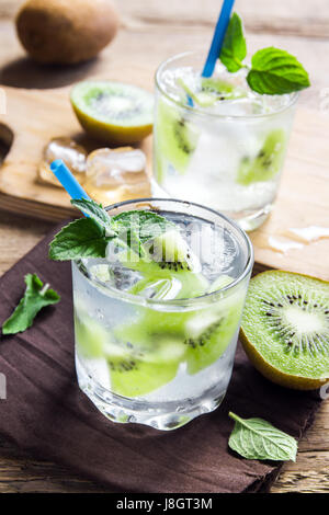 Kiwi drink (cocktail) with mint and ice in glasses close up - Stock Photo
