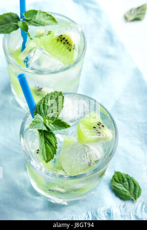 Kiwi drink (cocktail) with mint and ice in glasses close up. Cold summer drink. - Stock Photo