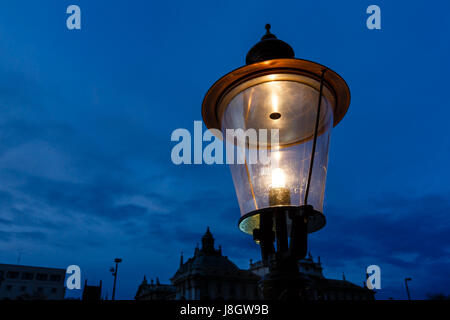 Vintage Illuminated Street Lamp in the Center of Munich, Germany - Stock Photo