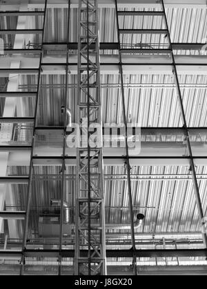 construction site with steel girders metal flooring and crane - Stock Photo