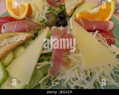 A culinary cheese and meats platter for lunch - Stock Photo