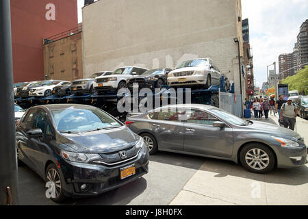 stacked mechanical parking lot in midtown New York City USA - Stock Photo