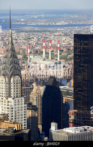 view north east over midtown looking towards the robert f kennedy bridge in astoria with chrysler building trump - Stock Photo