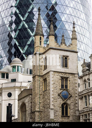 St Andrew Undershaft church in St Mary's Axe in the City of London, with the Gherkin skyscraper towering behind - Stock Photo