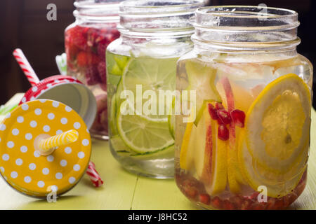 Fresh fruits flavored water healthy detox drinks in jars - Stock Photo