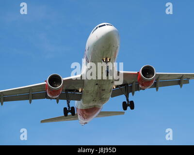 Air Canada Rouge flight  arriving at the Pierre Elliott Trudeau International airport in Dorval, Quebec - Stock Photo