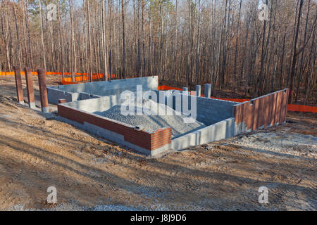 The garage of a new home under construction with rocks piled in the center - Stock Photo