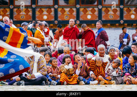 The crowd at Paro Tsechu, one of Bhutan's largest Tantric Buddhism festival celebrated in spring. - Stock Photo