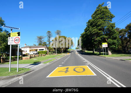 40 kmp speed limit sign in a school zone, New South Wales, NSW, Australia - Stock Photo