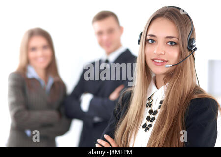 Portrait of beautiful cheerful smiling call operator on the background of business people. Successful call center - Stock Photo